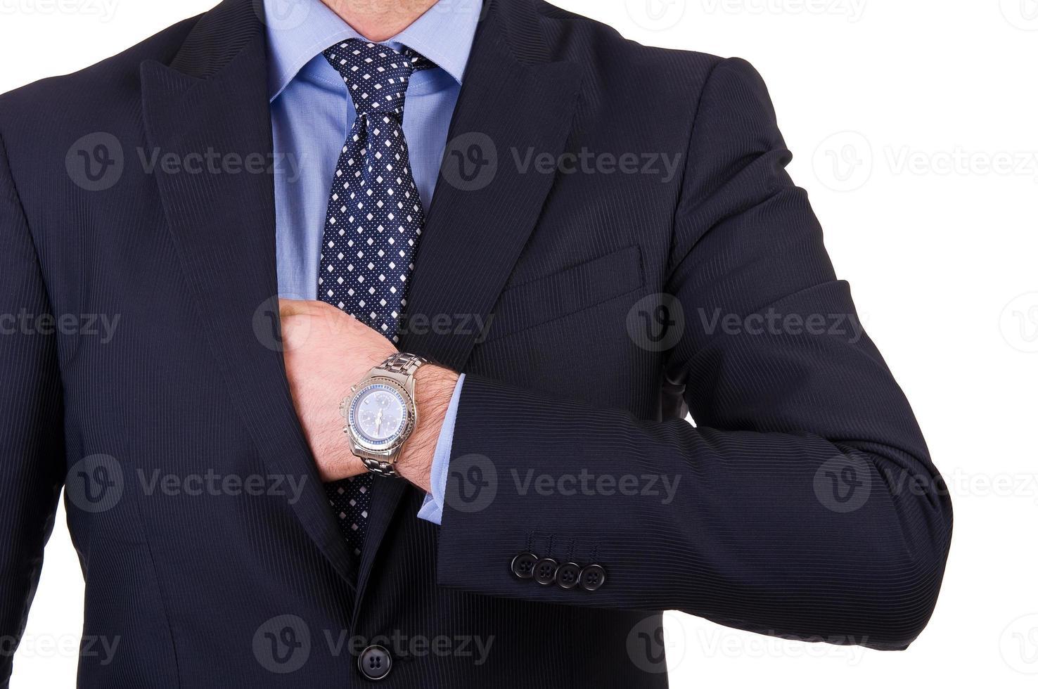 homme d'affaires, mettre quelque chose dans sa poche. photo