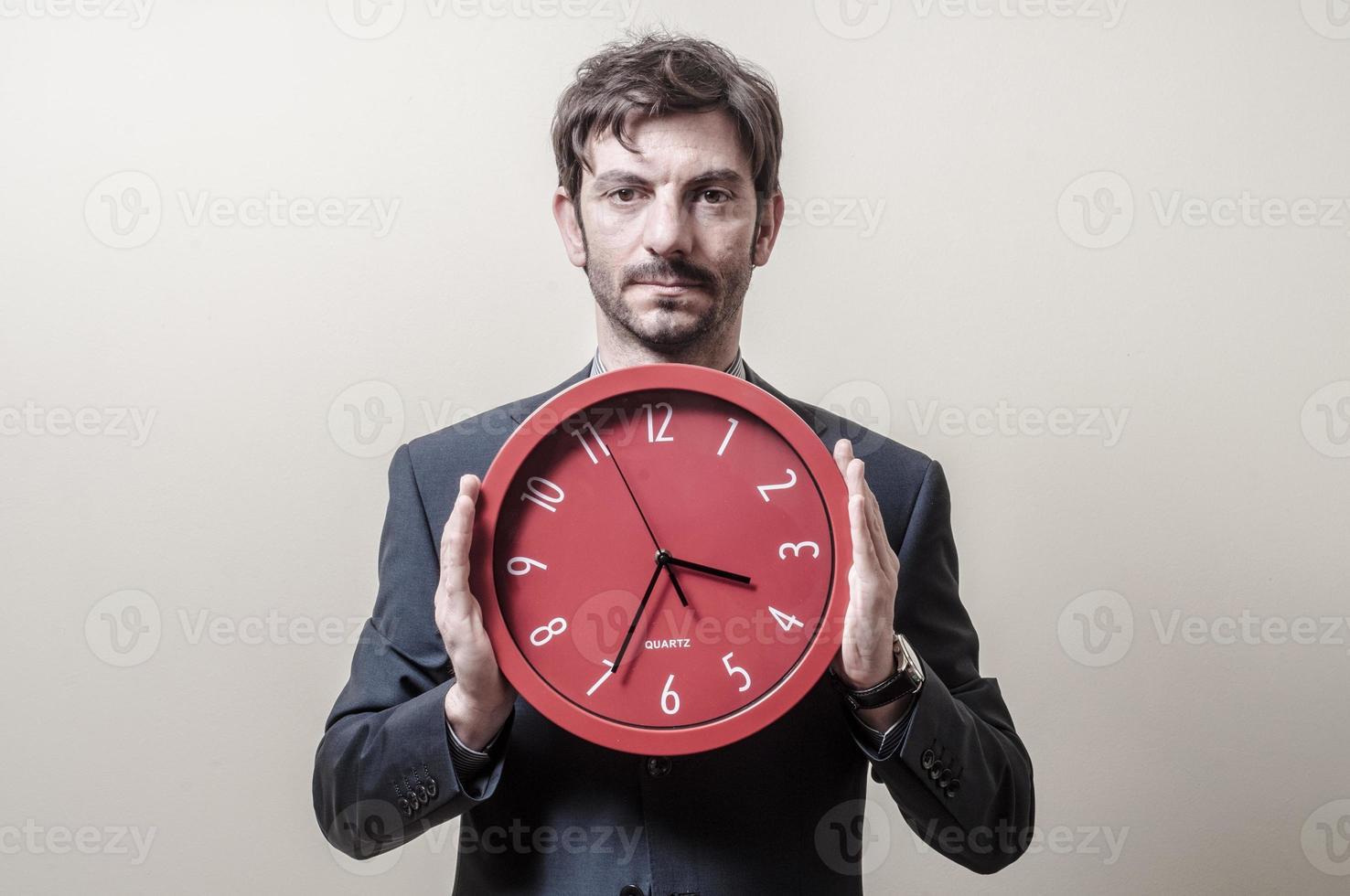 homme d'affaires avec horloge photo