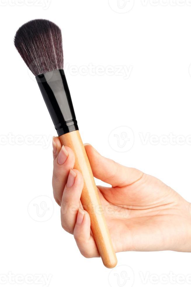 pinceau de maquillage à la main photo