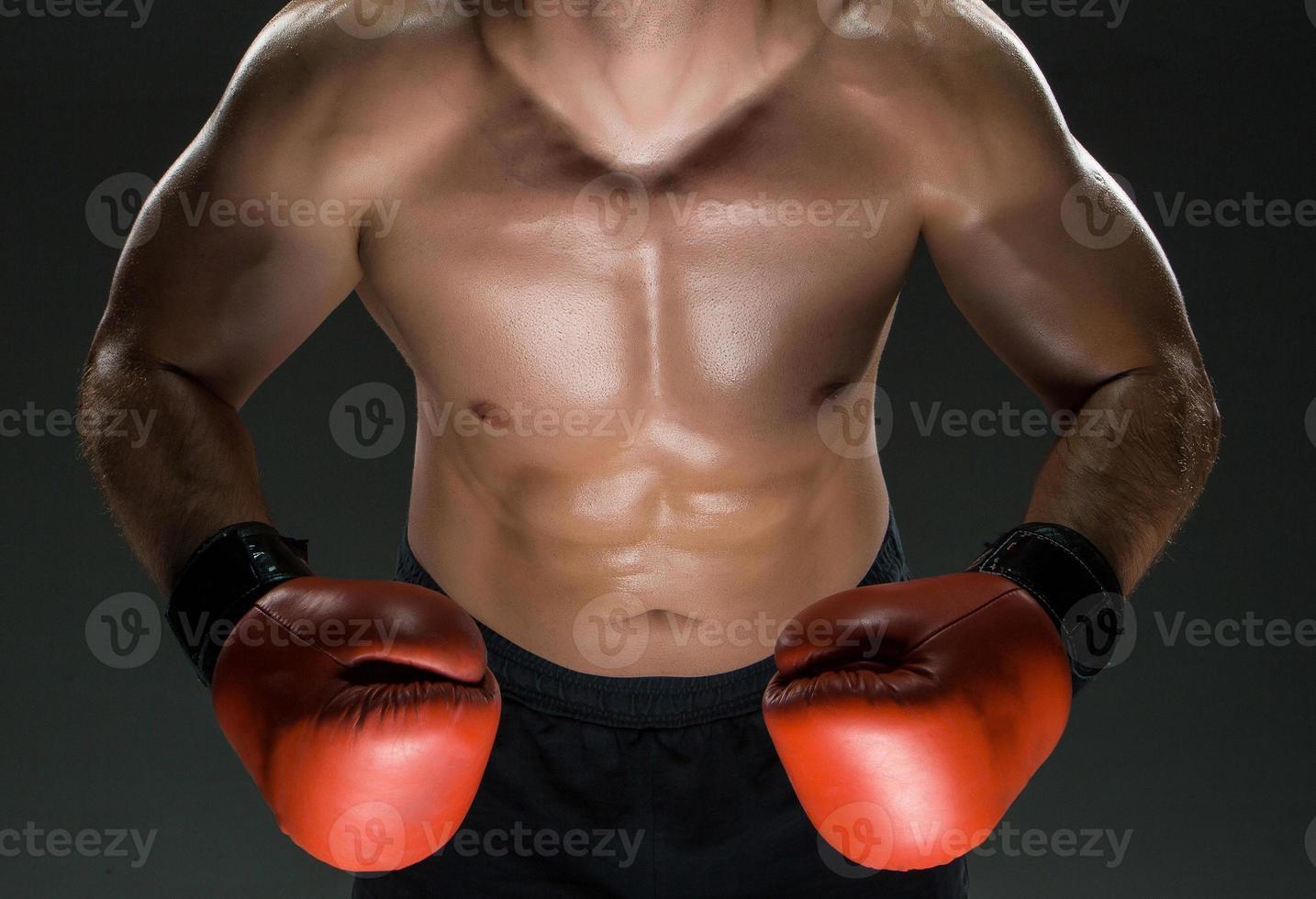 musculaire, jeune, caucasien, boxeur, porter, gants boxe photo