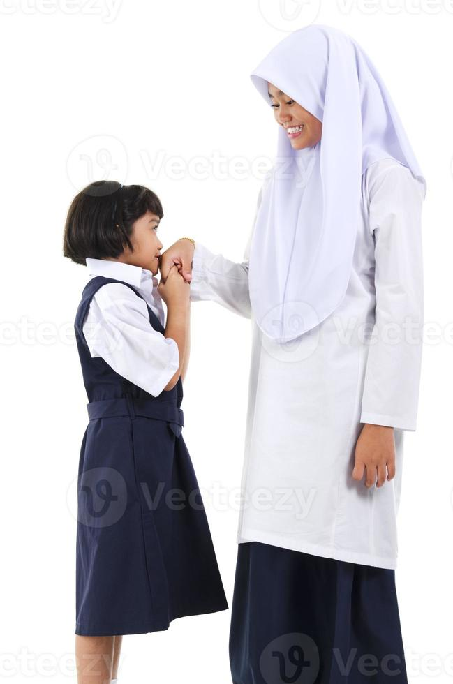 salutation de fille musulmane asiatique photo