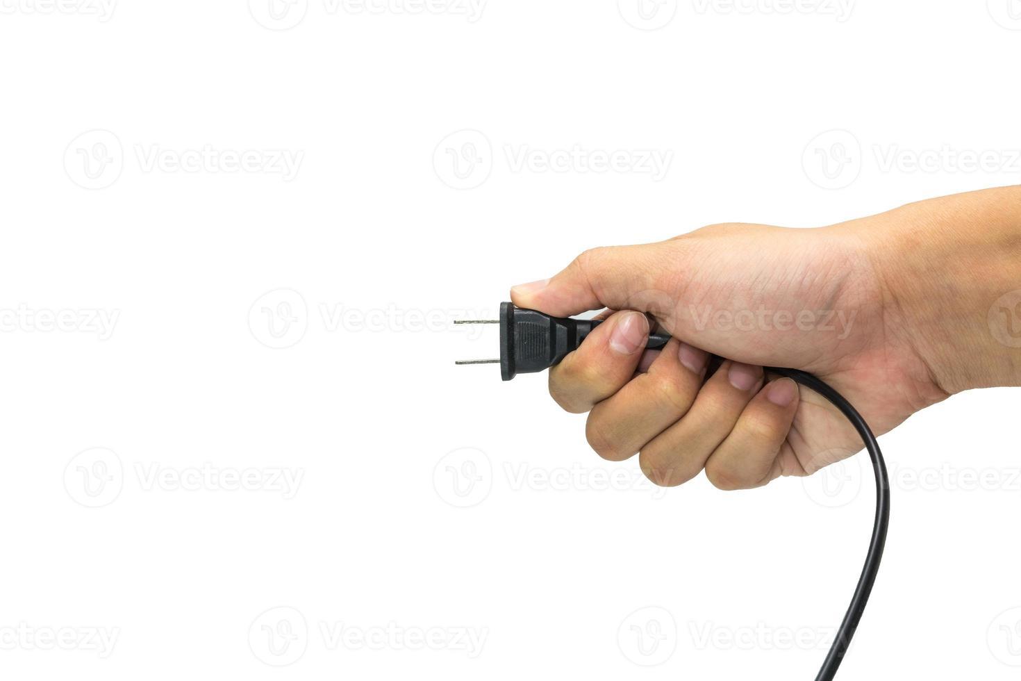 prise noire tenait à la main sur fond blanc. 2 photo