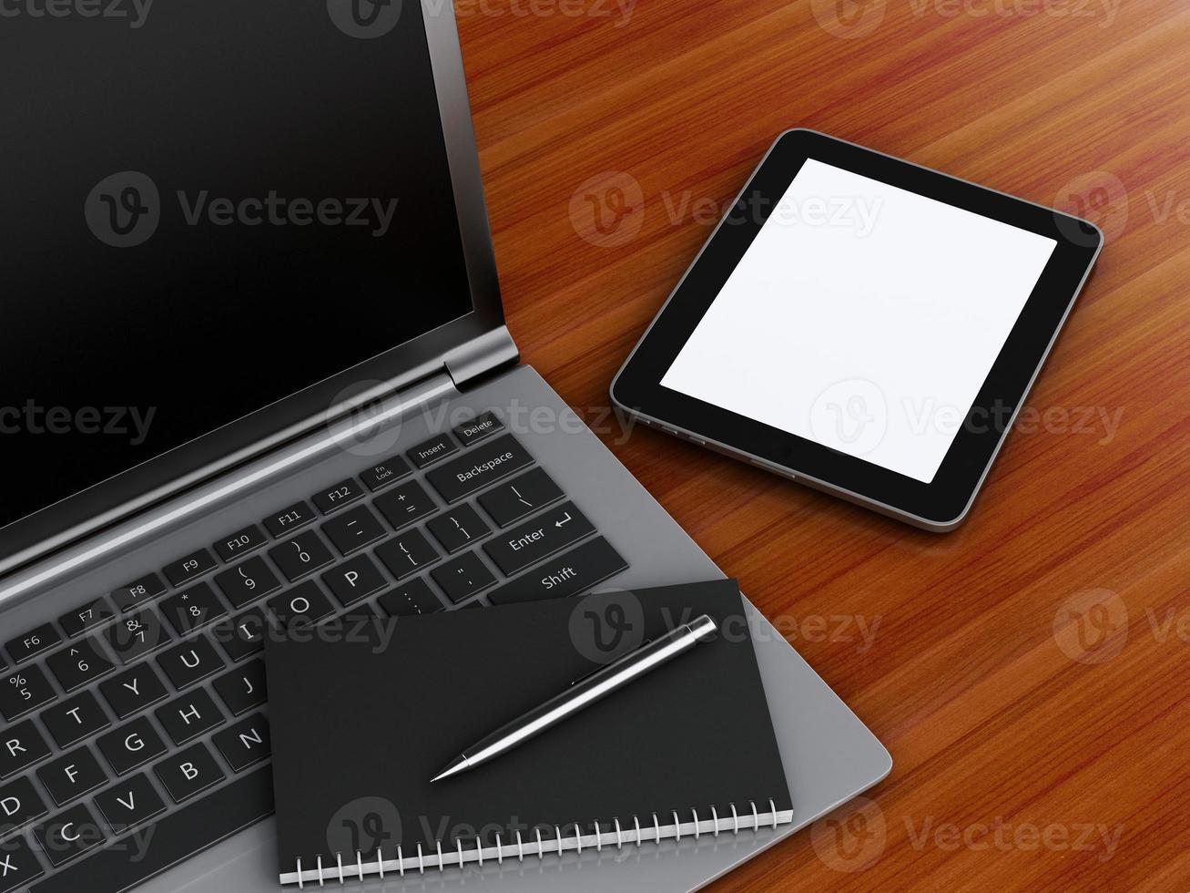 lieu de travail avec tablette numérique et ordinateur portable. photo