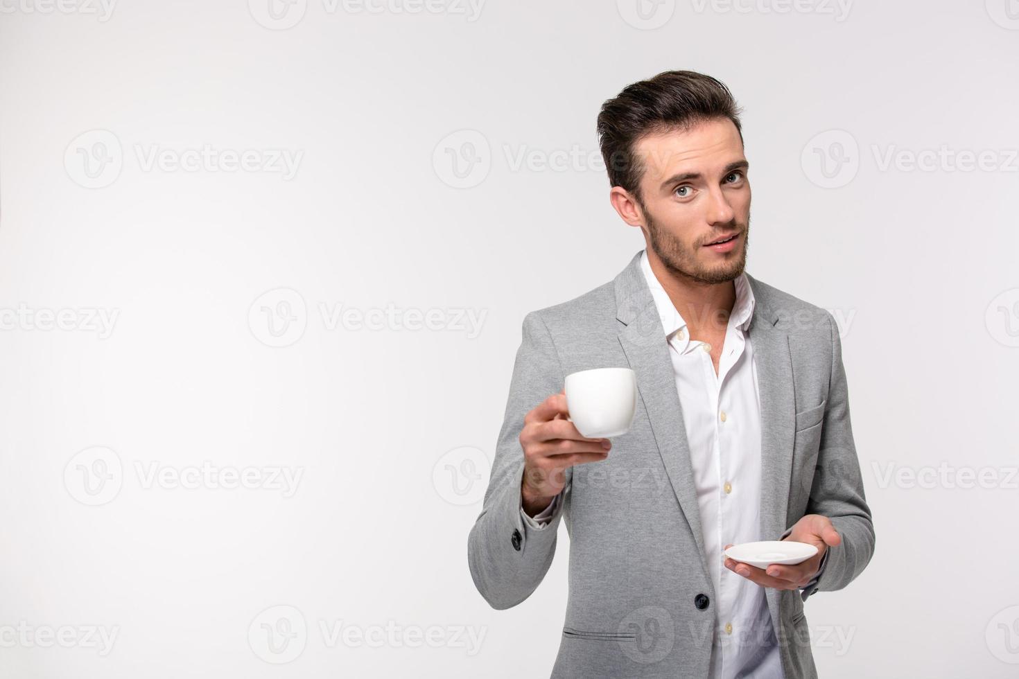 homme d'affaires heureux, boire du café photo