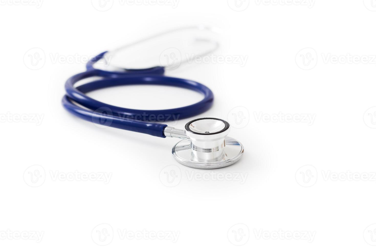 stéthoscope bleu sur blanc photo