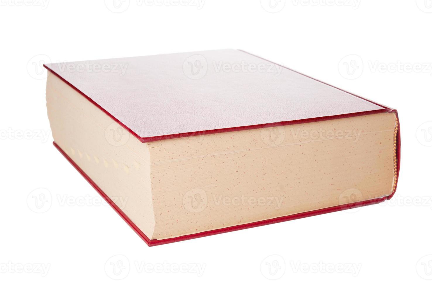 Gros plan du dictionnaire sur fond blanc photo