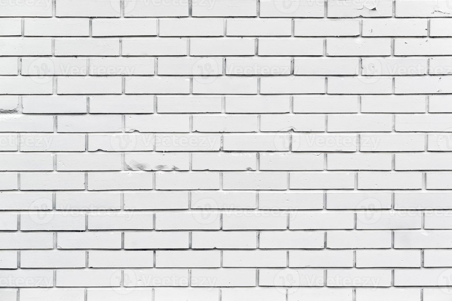 un mur de briques blanches avec motif et texture photo