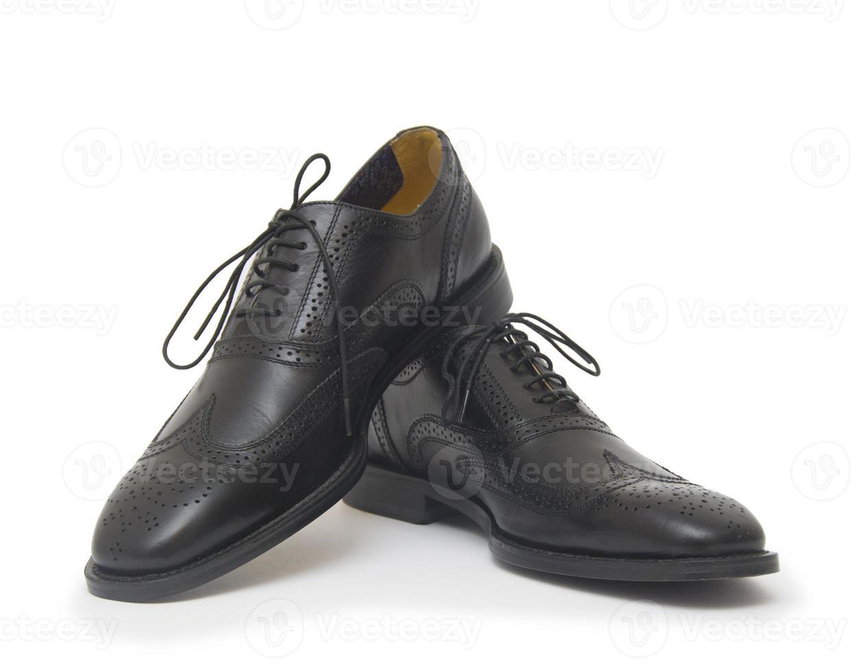 les chaussures de l'homme noir isolés sur fond blanc. photo
