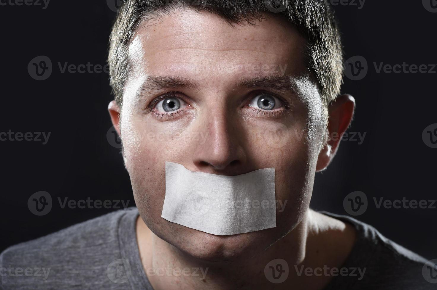 séduisant, jeune homme, bouche, scellé, sur, ruban adhésif photo