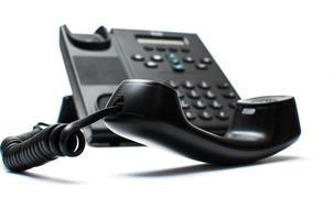 combiné noir et un téléphone photo