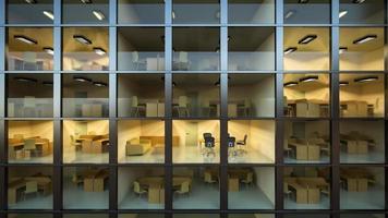 à l'intérieur d'un immeuble de bureaux moderne la nuit photo
