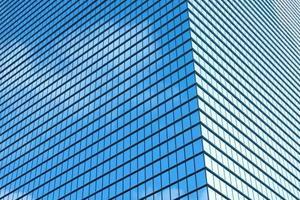 Gratte-ciel extérieur du bâtiment avec fond de fenêtres texturé photo