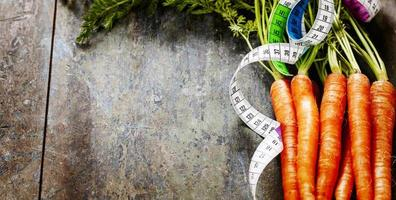 ruban de mesure de carottes fraîches photo