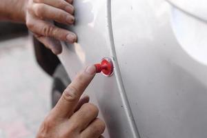 réparation carrosserie, vide, silicone photo
