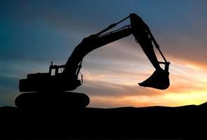 silhouette, excavatrice, chargeur, construction, site, élevé photo
