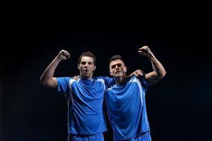 joueurs de football célébrant la victoire