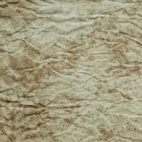 Texture et fond de papier brun très froissé