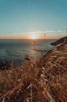 coucher de soleil depuis une falaise