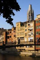 silueta de mujer sobre el rio en girona. photo