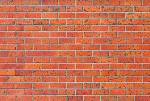 Texture et fond de mur de brique rouge en béton photo