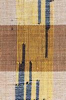 Surface de tapis de style péruvien thaïlandais coloré se bouchent.