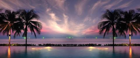 coucher de soleil mer plage palmiers piscine photo