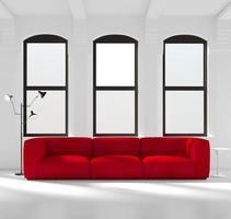 chambre blanche avec un canapé rouge photo