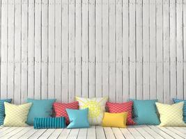 coussins colorés et mur avec des tableaux blancs