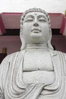 Sculpture de Bouddha sculpté en pierre gros plan