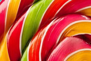 toile de fond de bonbons sucette colorée photo
