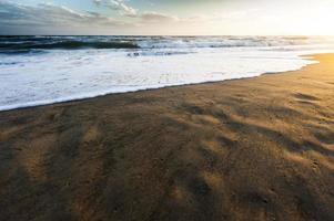 coucher de soleil italien sur la plage photo