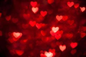 bokeh rouge de fond de coeurs