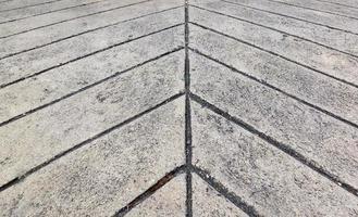 Surface du sol en béton de ligne en arrière-plan de flèche de mise au point douce photo