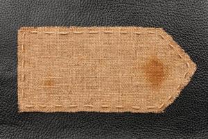 flèche de toile de jute, se trouve sur un fond de cuir photo