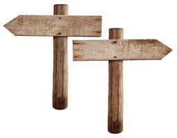 Vieux panneaux routiers en bois flèches droite et gauche isolés photo