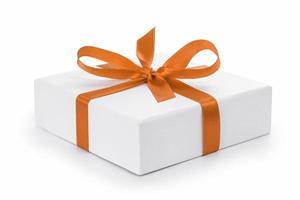 coffret cadeau texturé blanc avec noeud en ruban orange photo