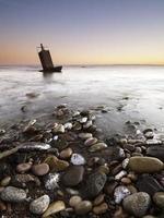 sommet géodésique traîné par la mer photo