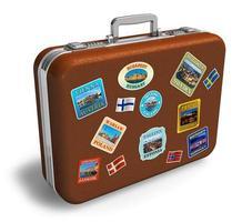 valise de voyage en cuir avec étiquettes photo