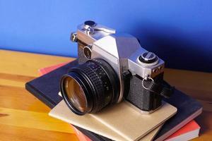 appareil photo et livres