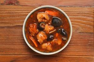 cuisse de porc ragoût de concombre de mer photo