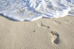 empreinte unique dans le sable