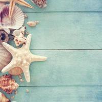 heure d & # 39; été avec étoile de poisson et coquillages photo
