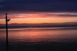Lever du soleil à l'entrée du quai 6h du matin en Irlande