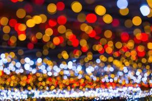 fond de bokeh circulaire de la lumière de Noël. photo
