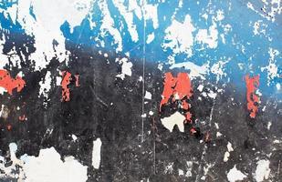 écaillage de peinture bleue et rouge photo