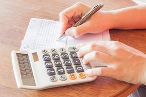 femme affaires, vérification, a, compte bancaire, livret photo