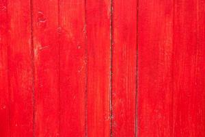 fond en bois peint en rouge photo