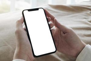 vue de dessus, de, femme, tenue, écran blanc, téléphone portable