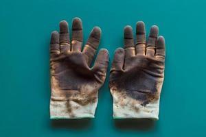 gants sur fond bleu