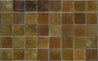 Gros plan d'une brique de grès - un fond texturé
